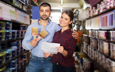 Couple with shop list in store