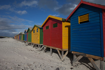Brightly colored beach huts in South Africa