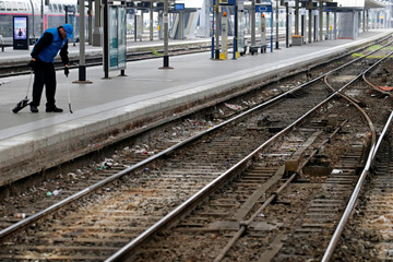 A worker cleans up a platform at the Gare Lille Flandres railway station during a nationwide strike by French SNCF railway workers in Lille