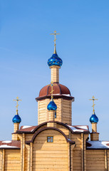 beautiful wooden Church with blue domes with stars