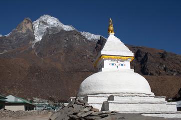 Mount Khumbila and buddhist white stupa near Khumjung village on the way to Everest base camp, Sagarmatha, Nepal Himalayas