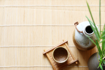 sake japanese oriental drink style on Bamboo table Top view