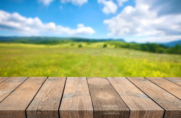 Wooden desk on natural background