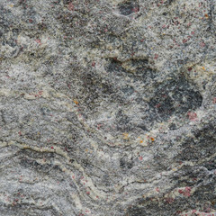 Gray texture of a stone with pink spots.