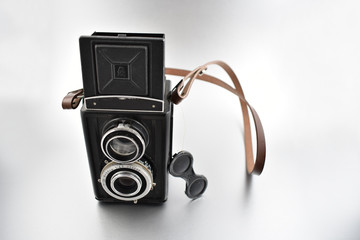 Old camera stock images. Vintage camera on a silver background. Old black Twin lens reflex camera