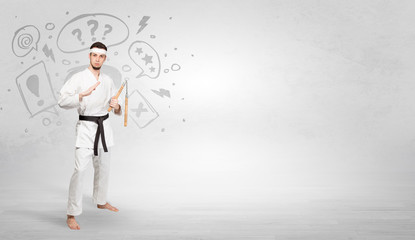 Young kung-fu trainer fighting with doodled symbols concept