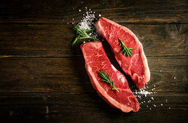 raw Picanha steak on wooden background in rustic style