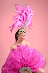 Foto auf AluDibond Karneval Beautiful girl in carnival costume with rhinestones and pink feathers.