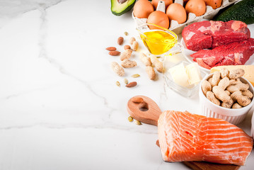 Ketogenic low carbs diet concept. Healthy balanced food with high content of healthy fats. Diet for the heart and blood vessels. Organic food ingredients, whiite marble background, copy space