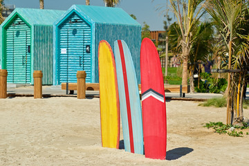 Surfboards and bathing cabins in Dubai