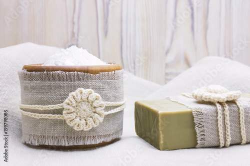 Handmade Natural Organic Olive Oil Soap And Cosmetic Salt On Linen Wooden Background