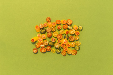 Assortment of colorful sweet handmade candy pieces arranged on green paper