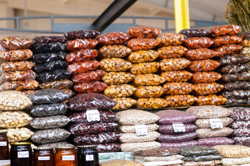 Spices, cereals and dried fruits on the market counter.
