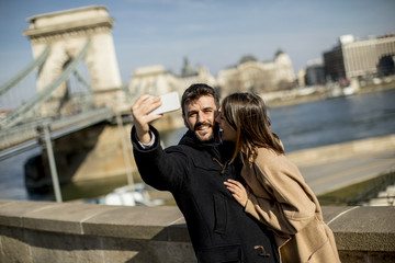 Portrait of loving couple taking selfie