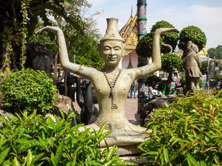 Bangkok, Thailand - Circa January 2018: Reusi Dat Ton (Thai Yoga) statue at famous Wat Pho (Buddhist Temple)