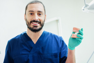 Dentist ready for a tooth surgical operation holding medical equipment