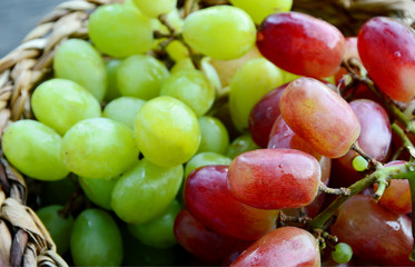 Green and Purple grapes in basket