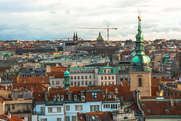 Panorama of the city of Prague. The old part of the city. Beautiful roofs of shingles. Ancient buildings and churches.