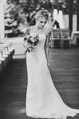 Portrait of attractive bride with wedding bouquet. Black and white photo.