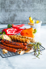 Grilled sausage with garlic and vegetables