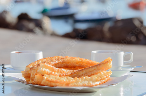 typical spanish snack churros are deep fried pastries and served
