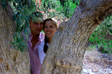 beautiful gorgeous couple on the tree of love cedar, on cyprus