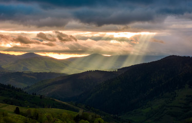 beams of light over the mountains