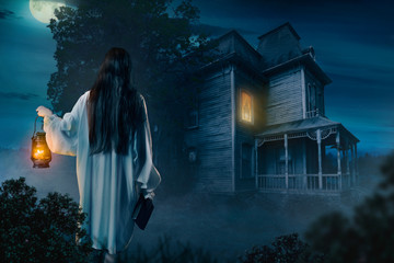 Female against abondoned house, moonlit night