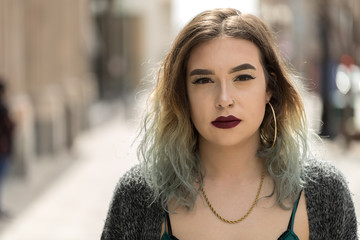Young woman in city face portrait