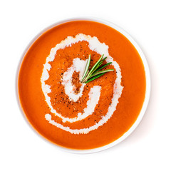 Tomato soup in a white  bowl  isolated on a white background. Gazpacho soup with herbs. Top view. Copy space.