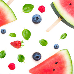 Watermelon  popsicle  pattern. Sliced watermelon  and berries   isolated on white background. Flat lay, top view. Summer wallpaper.