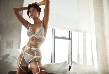 Portrait of a sensual young woman wearing sexy lace lingerie