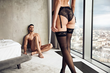 Portait of a sensual couple relaxing in a luxurious apartment