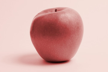 Photo of a red apple on a red background