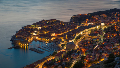 Dubrovnik, view of the fortress and the city wall with reflection in the water