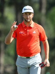 Jon Rahm of Spain holds up his ball on the 8th hole during final round play of the 2018 Masters golf tournament in Augusta
