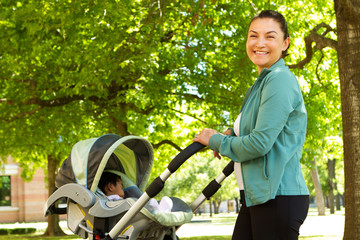 Mom pushing her baby in a stroller.