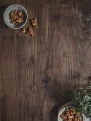 Wooden table with mixed nuts