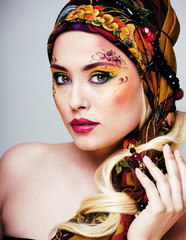 close up portrait of beauty woman with face art, russian style