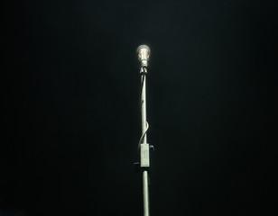 Microphone on dark background, music instrument concept