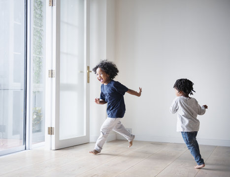 Young black boys polaying in their new house