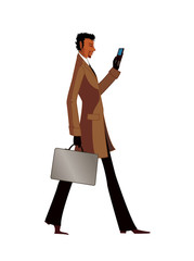 Side view of man holding mobile phone and suitcase