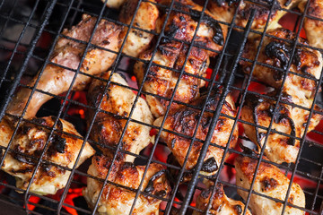 Barbecue from chicken meat on the grill.