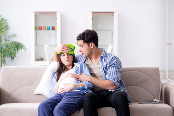 Pregnant woman with husband at home