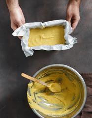 Fototapete - Man preparing corn bread top view. Healthy food concept