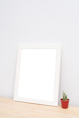 Blank Photo frame on wooden table in the room