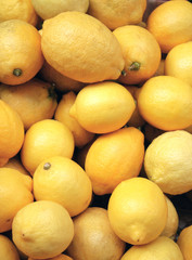 Ripe lemons in supermarket