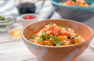Bowl with tasty shrimps and grits, closeup
