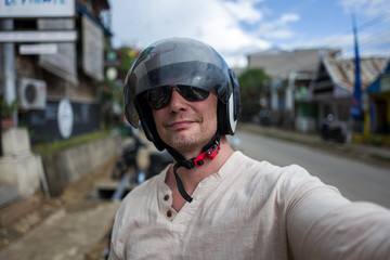 Selfie of man wearing helmet