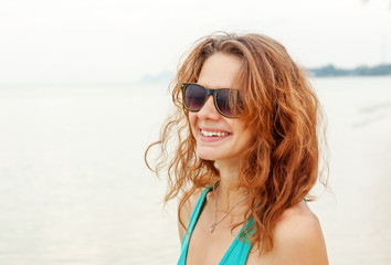 Portrait of a beautiful young funny woman girl in sunglasses